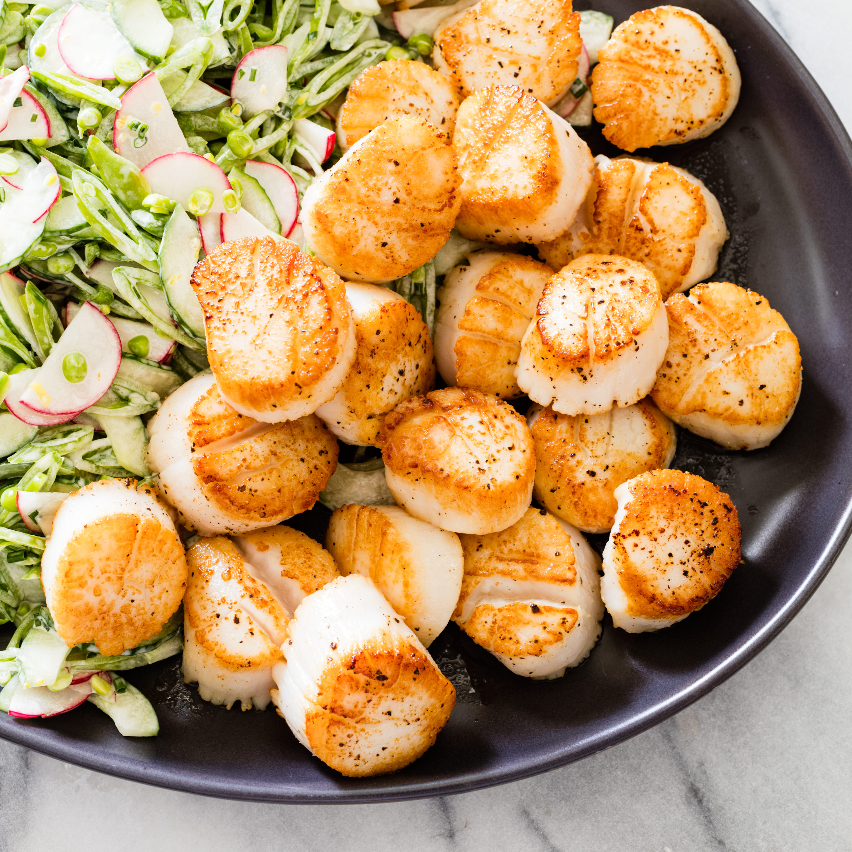 Pan-Seared Scallops with Sugar Snap Pea Slaw Recipe - Cook's Country