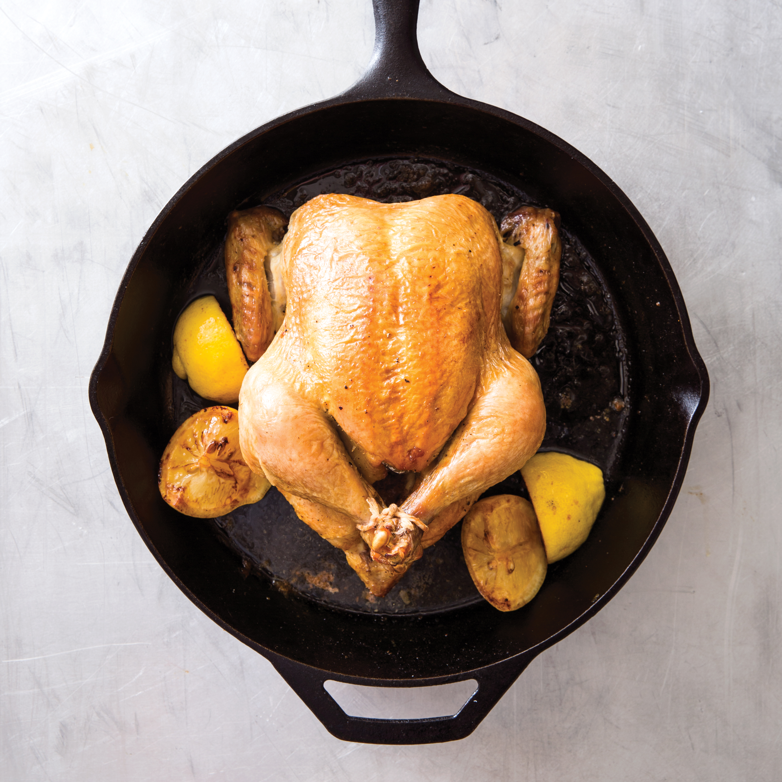 cast iron classic roast chicken with lemonthyme pan sauce test kitchen