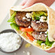 Charcoal-Grilled Greek-Style Lamb Pita Sandwiches with Tzatziki Sauce