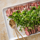 Grilled Frozen Steaks with Arugula and Parmesan