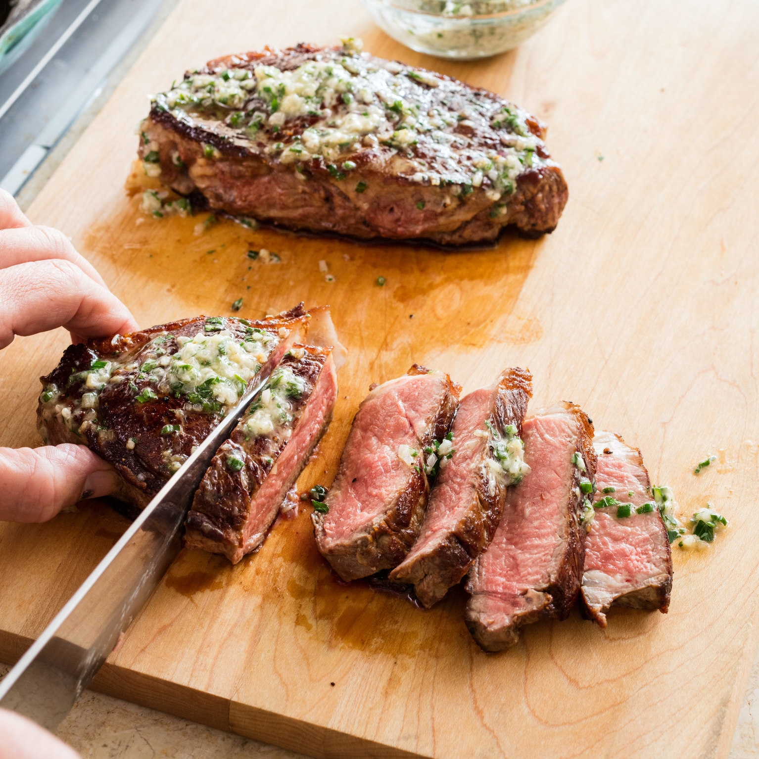 Cast-Iron Thick-Cut Steaks with Herb Butter | America's Test Kitchen