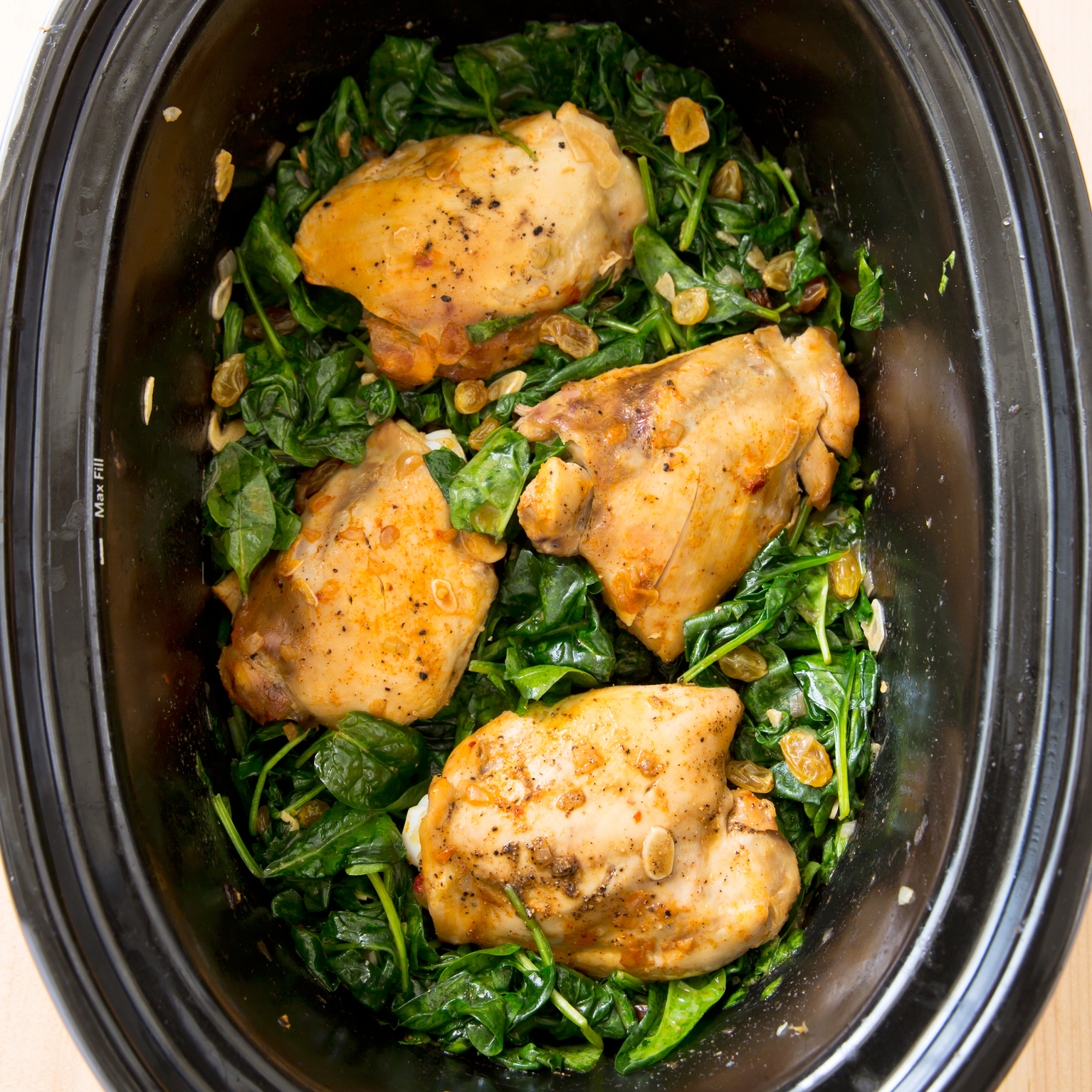 Slow-Cooker Braised Chicken Thighs with Garlicky Spinach ...