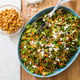 Bitter Greens, Carrot, and Chickpea Salad with Warm Lemon Dressing