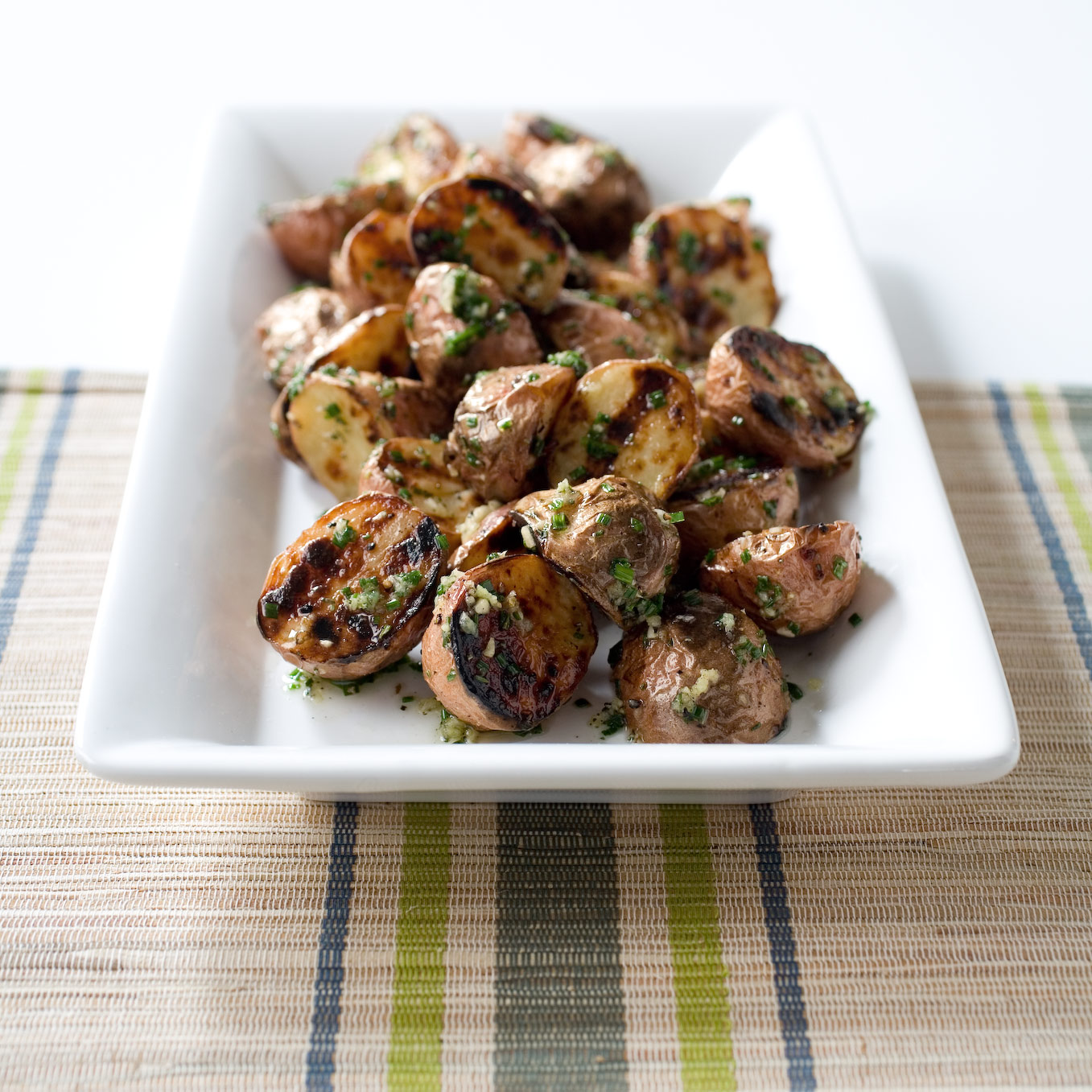Grilled Potatoes With Garlic And Rosemary On A Charcoal